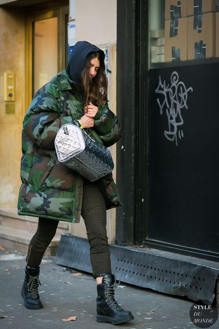 black hoodie + camo oversized puffer jacket + silver LV purse + olive pants + black combat boots