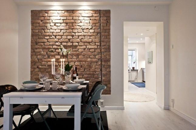 Una casa genial con paredes de ladrillo visto y detalles como los azulejos del metro. ¿Qué detalle os gusta más?