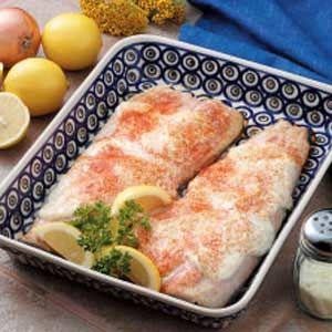 "Baked Trout Fillets Recipe -Moist tender trout is draped in a creamy Parmesan cheese coating that makes this dish elegant enough to serve company. ""I picked up this recipe at the campground where we were staying,"" says Mary Zimmerman of Spring Lake, Michigan. ""I also use the delicious sour cream mixture on salmon."""