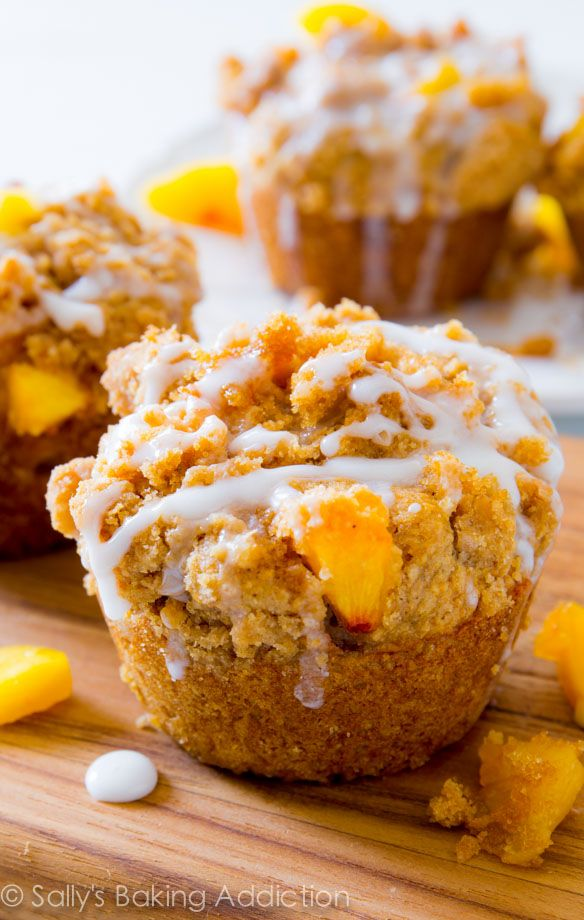 One seriously sweet muffin! These buttery peach muffins are loaded with flavor, crumb topping, and sweet glaze.