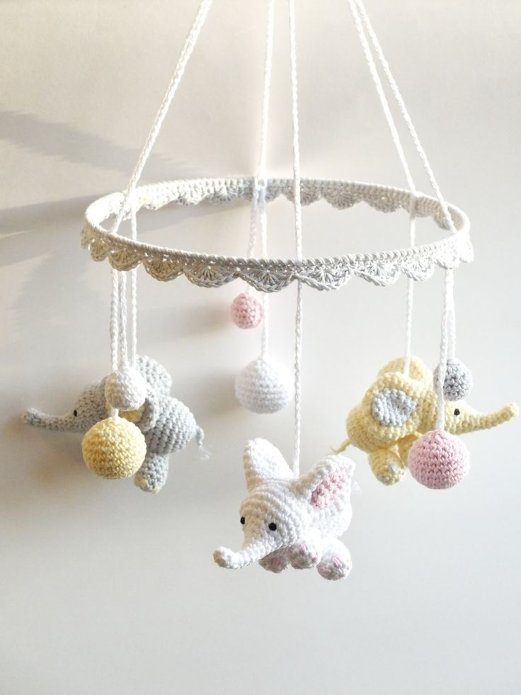 This lovely crochet baby mobile with cute baby elephants, little good luck bringers for a newborn, makes a beautiful, one of a kind baby shower gift. The baby mobile is made of 100% cotton yarn in white, yellow, pink and gray. It is ideal to hang over a baby crib, baby changing table or simply anywhere in the nursery just to brighten up the babys room.  The item is handmade with love and care.   Color: white, light yellow, light pink, light gray Material: 100% cotton yarn, metal ring Size…