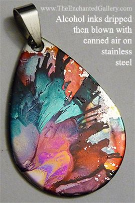 Alcohol inks dripped then blown with canned air technique for splatter paint effect on stainless steel pendant blank flat charm from The Enchanted Gallery www.TheEnchantedGallery.com using Ranger Ink's brand Adirondack Tim Holtz inks.