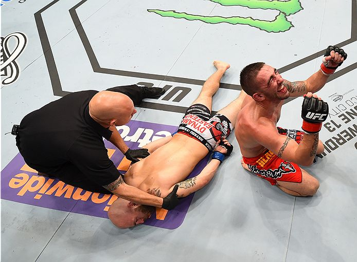 NEW ORLEANS, LA - JUNE 06:   (R-L) Joe Proctor celebrates his submission victory over Justin Edwards in their lightweight bout during the UFC event at the Smoothie King Center on June 6, 2015 in New Orleans, Louisiana. (Photo by Josh Hedges/Zuffa LLC/Zuffa LLC via Getty Images)