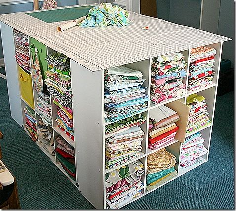 Great idea for a cutting table (made from 4 cube style book shelves). You can find these at Target or Ikea.