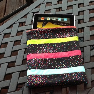 A quilted iPad cover--made with a free pattern from www.modabakeshop.com.  It is called the iPad sleeve.  Very easy to make.  I used scraps fabric from other projects.