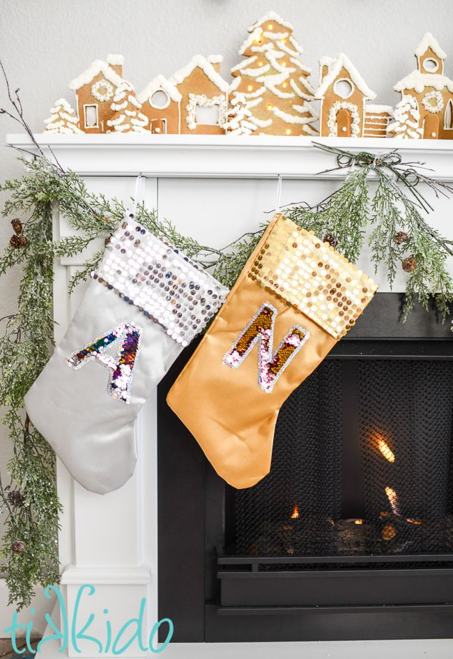 2796bfbfe7c Christmas stockings with mermaid sequin reversible fabric monograms on  silver and gold stockings on a white fireplace mantle.
