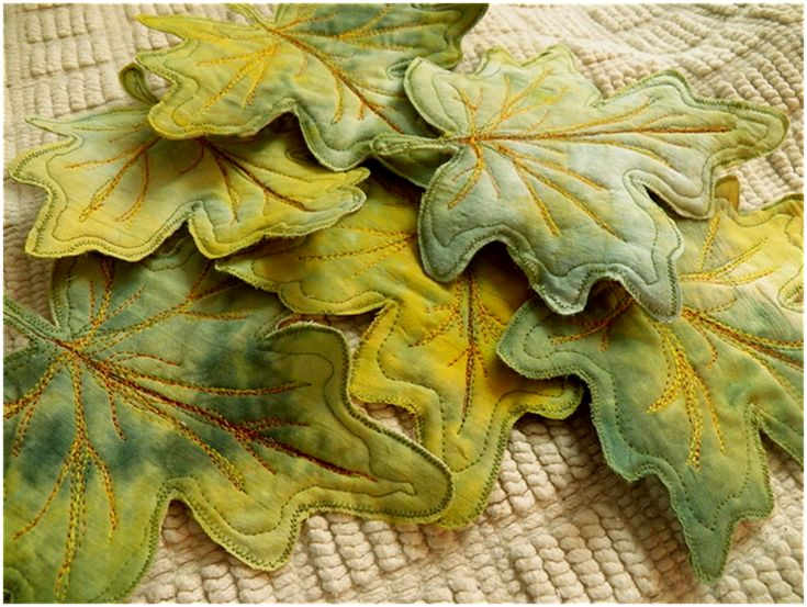 Love these leaves (coasters), and she used thread painting to sew in the veins.