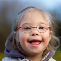 Down syndrome is a common genetic disorder. What are the signs and symptoms of Down syndrome, and how can it be diagnosed and treated?