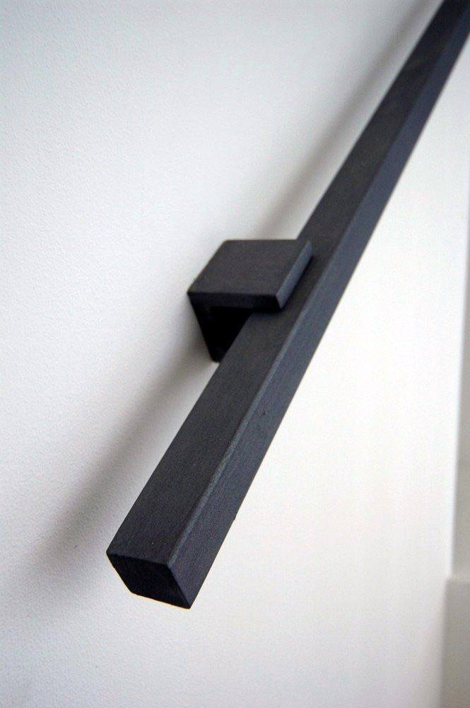 If I go with a half wall on the stair a rail like this could work.
