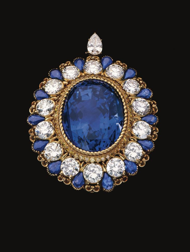 """he extraordinary """"Notre Dame"""" clip set with an unheated oval-shaped Ceylon sapphire of 133.63 carats, along with 14 round diamonds weighing 16.95 carats, bordered by 14 pear-shaped sapphires of 8.22 carats, further accented by 49 yellow diamonds of 1.60 carats and completed at the top with a pear-shaped diamond of .94 carat, 1980."""