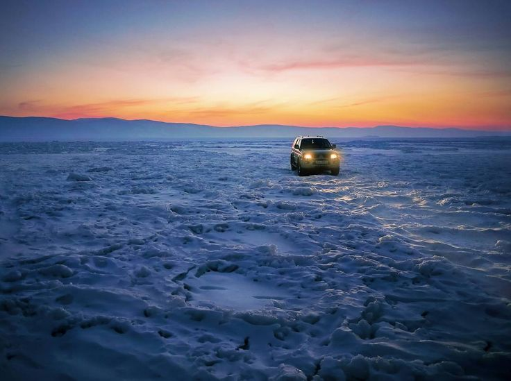 """Frozen Lake Baikal. """"Looking forward  to find a way which brings me home.""""   wicked capture by @simonmatzinger   #Khuzhir #Russland #adventuremobile #offroad #mitsubishi #outlander #4x4 #roadtrip #roadtripping #explore #exploring #adventure #offroadadventures #ice #frozen #sunset #landscape #nature #landscapephotography #adventurelife #liveadventurously #lifeisanadventure #livetoexplore #keepexploring"""