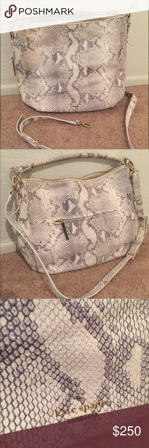 Kate Spade Cobble Hill Luxe Ella Snakeskin Print Kate Spade Cobble Hill Luxe Ella Snakeskin print Cross body handbag  Great Condition! Used only once.  Color: Cream and Grey Snakeskin print Style: #: PXRU5695 Zipper top, 1 zipper poker outside, 1 zipper and 2 pockets inside interior slide pockets Measurements Approx: 12 in  H X 15 in W X 2 3 in D.  Strap drop length: Adjustable Strap kate spade Bags Shoulder Bags