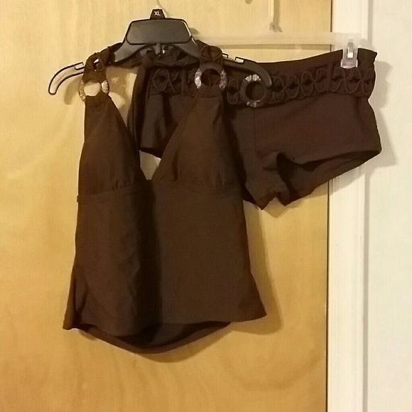 Brown Swim Outfit Cute little brown and beige tankini with brown shorts. Both piece have a brown belt with a beige circular piece They have only been worn once and clean afterwards :) Swim
