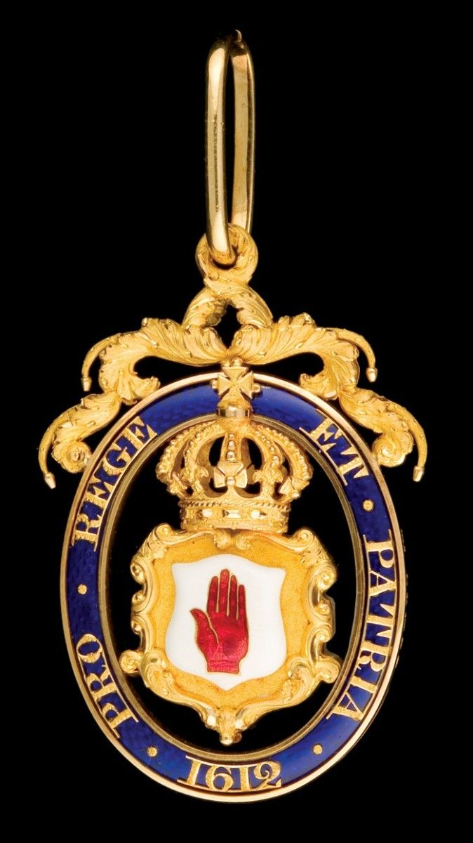 Baronet's Badge, a magnificent double-sided badge in finely-worked 18 ct. gold and enamels by William Neale, London, 1842, of unconventional openwork form bearing the motto pro rege et patria and date 1612 on a blue-enamelled oval enclosing crowned shield bearing the red hand of Ulster, with highly elaborate scroll suspension and riband carrier, 72 x 44mm, virtually as made and of excellent workmanship