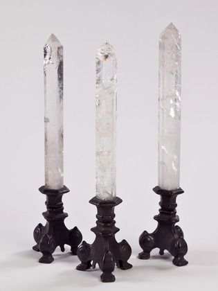 crystal obelisk on black brass base . I would like one in every room... thank you very much