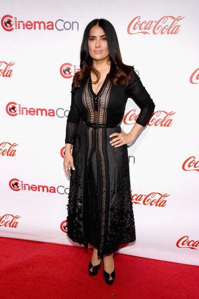 Salma Hayek Peep Toe Pumps - Salma Hayek complemented her dress with black platform peep-toes by Charlotte Olympia.