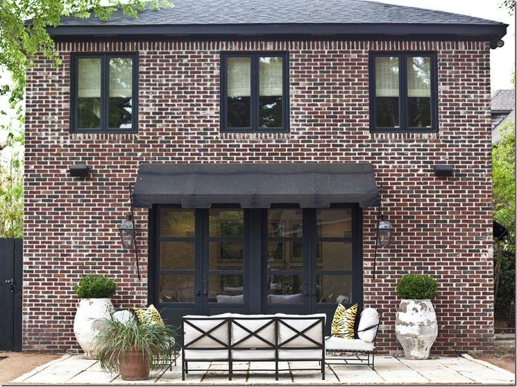Red Brick Dark Roof Black Window Frames Exterior