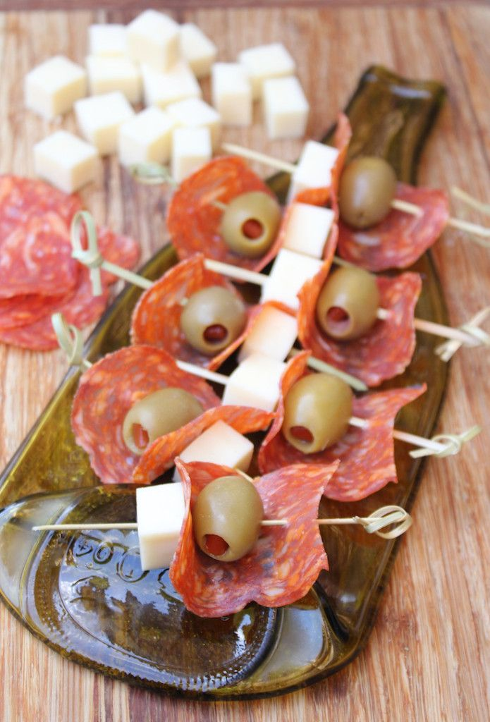 Antipasto skewers with salami, olives and mozzarella