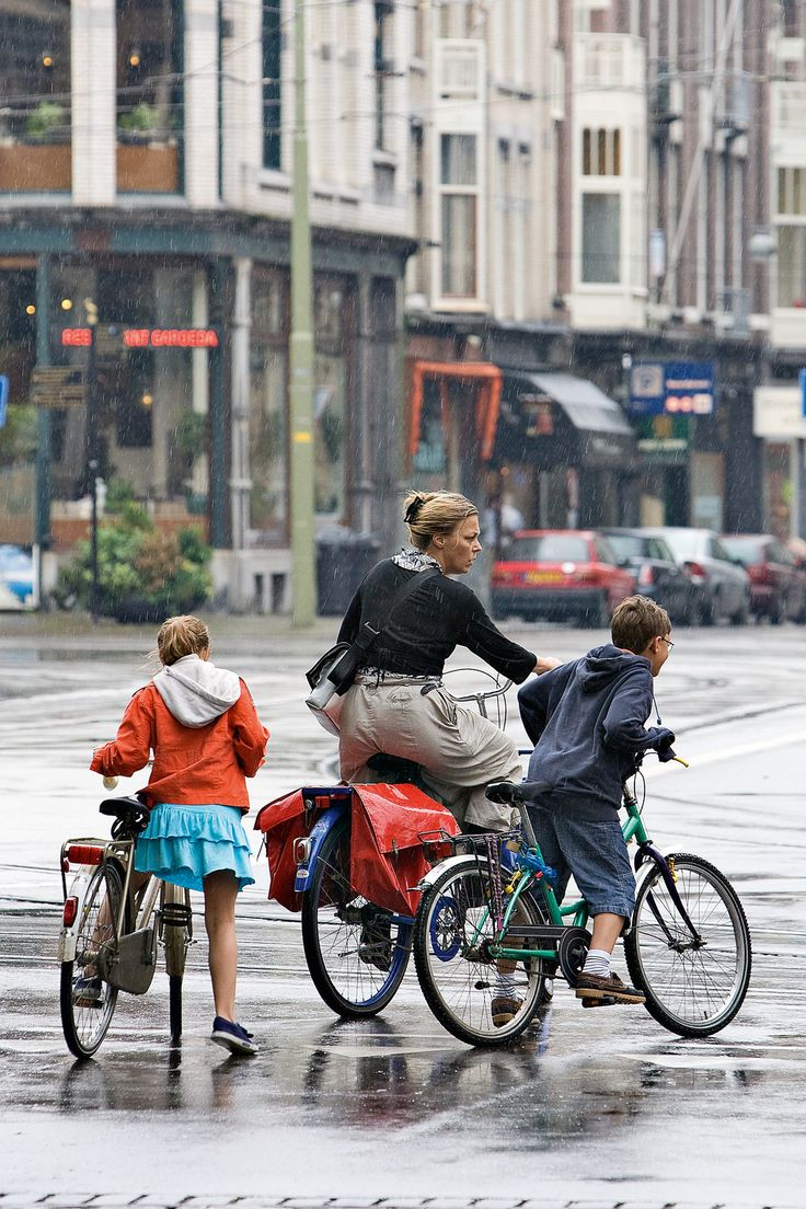 A touch of rain never stops the Dutch from cycling!