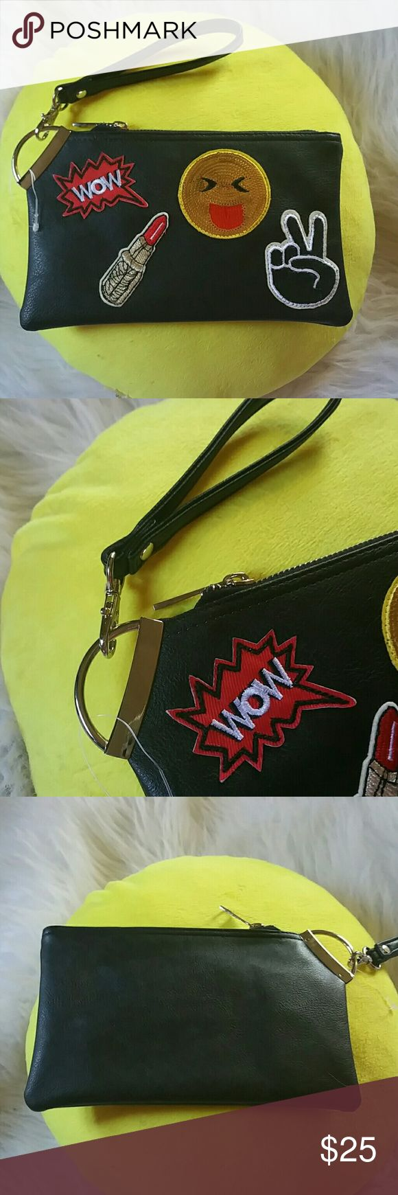 BNWT- CUTEST CLUTCH/WRISTLET Black with peace sign, lipstick, Emoji sticking out the tongue and wow! Brand new black with black wristlet wristlet can come off to use as a clutch great for a night out with the girls maybe a movie or a  present Boutique  Bags