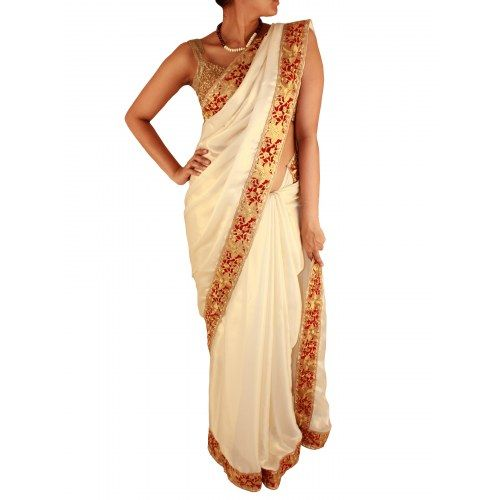 Pearl white satin saree with red and gold cutwork pattern