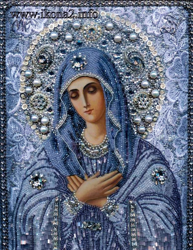 """Replica of the """"Virgin of Tenderness"""" icon of the Most Holy Mother of God depicting her humble and chaste reaction to the Annunciation. The original icon belonged to Saint Seraphim of Sarov, who always held a lit candle before it."""