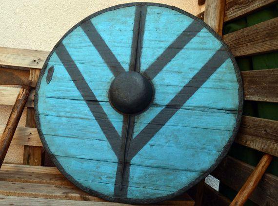 He encontrado este interesante anuncio de Etsy en https://www.etsy.com/es/listing/510534085/collectibles-viking-shield-ladgerda