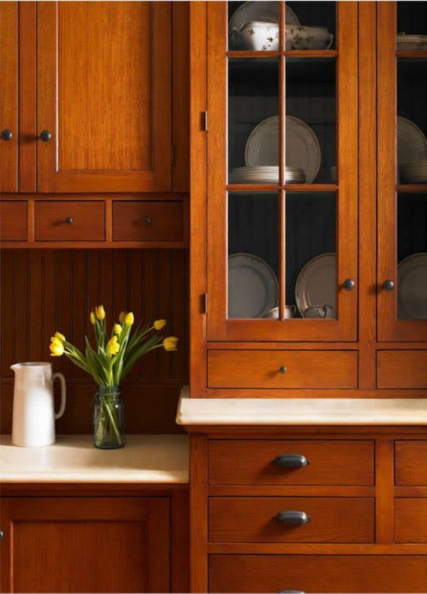 Small drawers/cubbies under cabinets--would this help push those cabinets up to the ceiling? Light/white countertop with inset dark wood cabinets