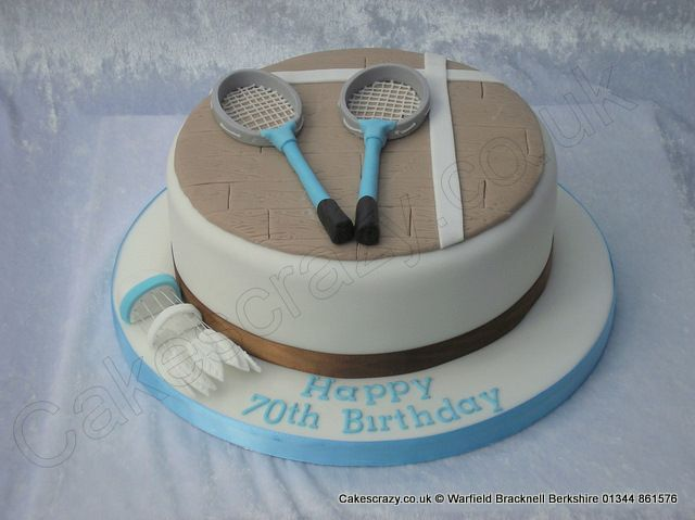 Badminton cake with rackets and shuttlecock, covered to give the appearance of the court floor http://www.cakescrazy.co.uk/details/badminton-cake.html