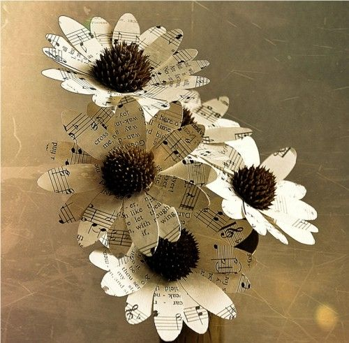 Daisies Made of Vintage Music Sheets  http://www.artfire.com/ext/shop/product_view/AccentsandPetals/4624050/Two_Dozens_Daisies_Made_of_Vintage_Music_Sheets/Wedding