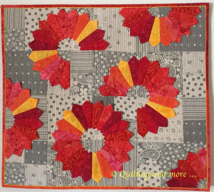 Double pointed Dresden plate quilt by Sandy Mike. Design by Susan Cleveland.