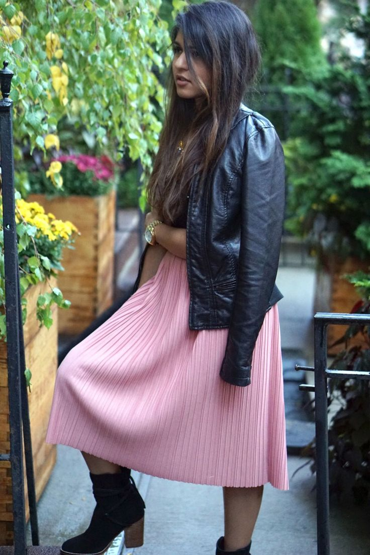 Woman wearing smart casual pleated skirt and leather jacket | Skirt The Ceiling