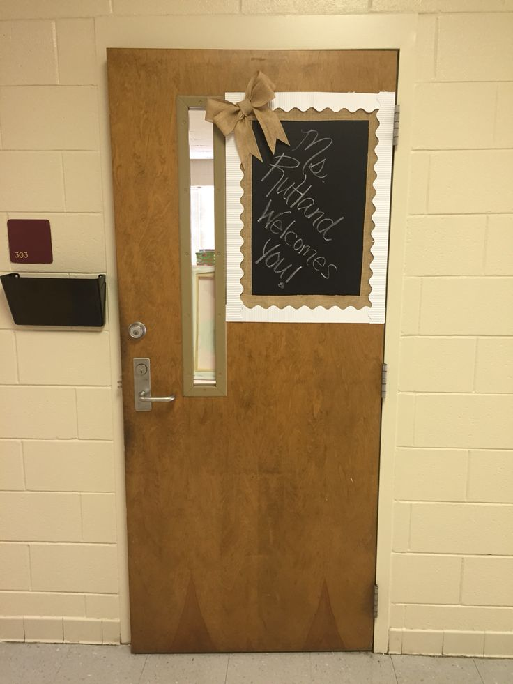 My new door display. It was super easy to do. All you is chalkboard contact paper, burlap, and border of your choice.