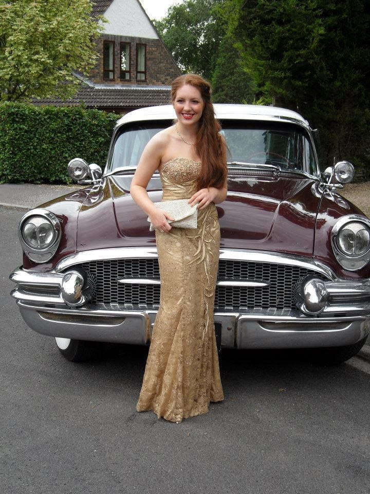 Customer Anya Eastman looking classicly glamorous in our 40s style beaded gold lace strapless gown. Love the car! #vintagestylegowns #classicglamour #bluevelvetvintage