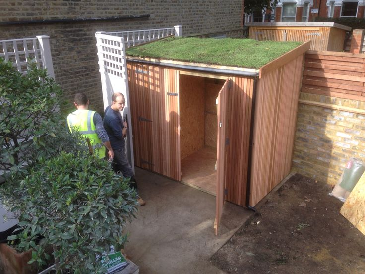 5 bike hang in bike shed with cedar cladding and sedum roof