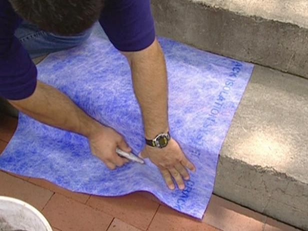 To give your drab concrete porch a wonderful tile facelift, follow the steps of the DIYNetwork.com masonry experts.