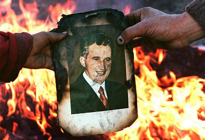 Charred portrait of the dictator Ceausescu on 22 December 1989