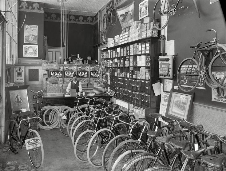 """1910. """"Cycle shop interior. Christchurch, New Zealand."""" B.S.A. stood for Birmingham Small Arms. Photo by Steffano Francis Webb."""