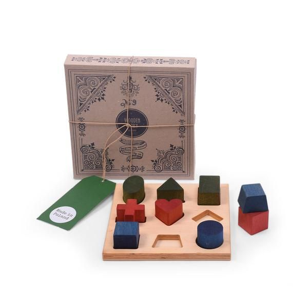 Wooden Story Rainbow XL Shape Sorter Board. Identify sizes and shapes with this gorgeous shape sorter. Made of selected wood that comes from FSC certified suppliers and finished with eco-rainbow stains, beeswax and botanical oils and sanded perfectly smooth, soft to the touch.  Packed in a cardboard gift box and tied with string. Product eco. Made in the Beskidy Mountains.