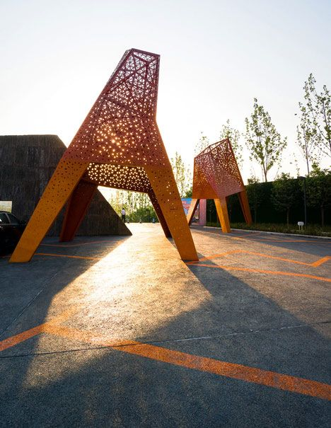Four-legged perforated metal pavilions rise above Fengming Mountain Park