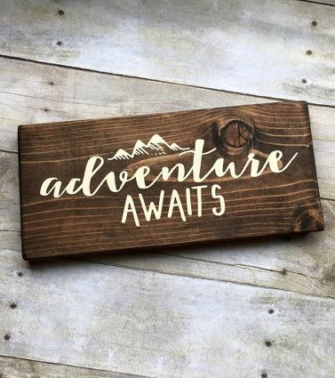 'adventure awaits' wooden sign