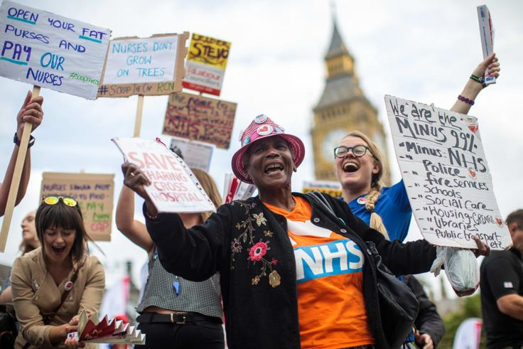 6 September, London: Demonstrators chant and wave placards in Parliament Square during a protest against the government's 1% cap on public sector pay.
