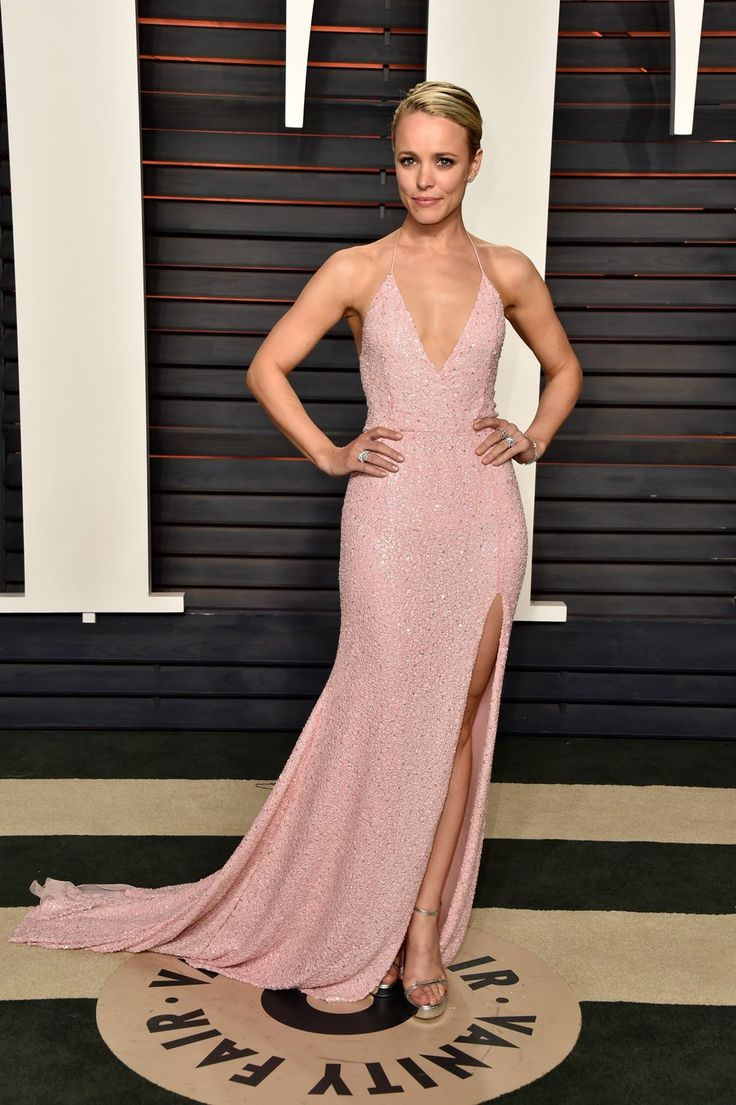 After wowing in her dark green August Getty Atelier gown, Rachel McAdams slips into an equally impressive embellished pink number.