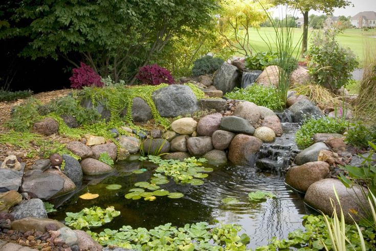 Waterfall ponds waterfall and winding stream spill for Small yard ponds and waterfalls
