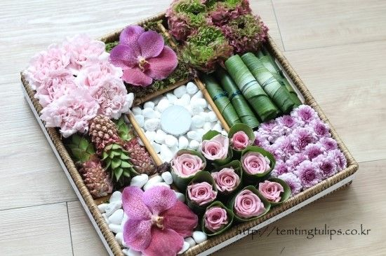 Pinks, lavenders and greens table arrangement