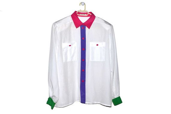 Women's white button up blouse with colorful details.