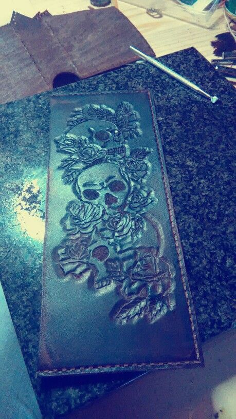 Fully tooled skulls and roses design for a wallet