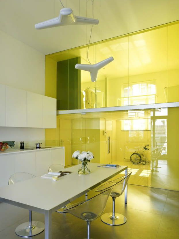 An old school building. Two class rooms with mezzanines. Design bydmvA with One colour; yellow. Yellow painted floors, walls and ceiling, yellow layered glass, yellow light, yellow bath, yellow sink...