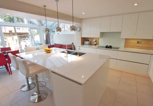 Kitchen islands make beautiful additions yet are also extremely practical; This kitchen island with breakfast bar contains an integrated dishwasher and washing machine, sink & tap, bin system and also has reduced depth base units to allow chairs to fit neatly underneath the breakfast bar. #breakfastbar #kitchen #whitekitchen