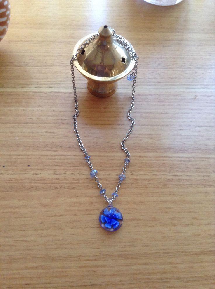 Blue glass flower pendant